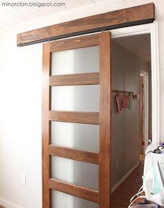DIY Sliding Door... cost effective solution and looks super sleak. Good overview on blog...