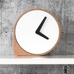 Dutch designer Ilias Ernst has created a simple clock that rests on an corner extended from its cork frame