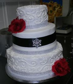 Black, red and silver wedding cake