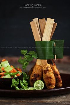 Post: Balinese Chicken Sate Very clever presentation. Adds height and interest to a type of dish that can sometimes be boring on the plate.Very clever presentation. Adds height and interest to a type of dish that can sometimes be boring on the plate. Indian Food Recipes, Asian Recipes, Indonesian Cuisine, Chicken Satay, Food Decoration, Food Presentation, Food Plating, Food Design, Food Styling