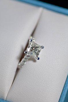 Square diamond engagement ring.