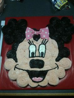 Minnie mouse cupcake cake - Yellow cupcakes with vanilla and chocolate icing complete with a pink fondant bow!
