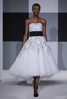 Brides: Isaac Mizrahi for Kleinfeld - Spring 2013. Strapless black and white tulle A-line wedding dress with a tea-length hemline, banded waist, and soft scoop neckline, Isaac Mizrahi for Kleinfeld