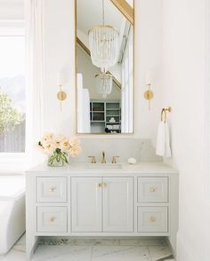 What a beautiful and serene bathroom. I love everything about this beautiful corner. The vanity color, the large mirror, the countertop…