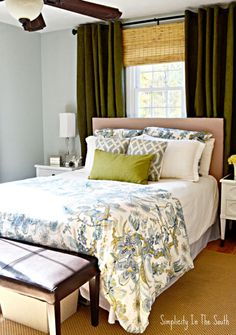 Master bedroom in blues and greens. This color palette makes the room feel like a restful retreat but keeps the room from being too feminine.