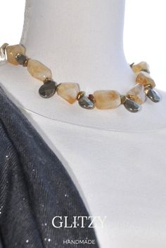 A Beautifl creation with warm colors for an amazing look!SORBETTO necklace handmade with STONES IN CITRINE, PYRITE drops and KESHI pearls.