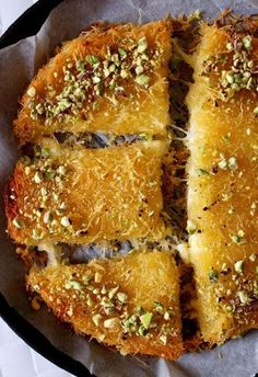 Knafeh bil Jibne (Can substitute ricotta and mozzarella for the cheese) Lebanese Desserts, Lebanese Cuisine, Lebanese Recipes, Turkish Recipes, Persian Recipes, Middle East Food, Middle Eastern Desserts, Middle Eastern Dishes, Arabic Dessert