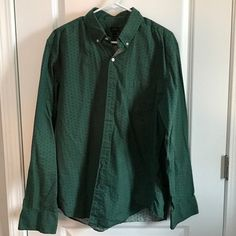 Green button down with small blue flower. Excellent condition smoke free home