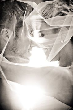 Wedding Photography | A gorgeous wedding photo of the bride and groom through the veil