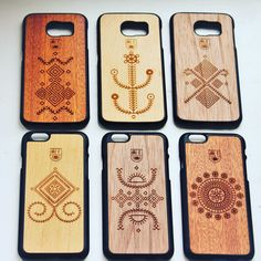 Lithuanian ethno motives on wooden cases. Different kind of wood: alder, walnut and mahogany.