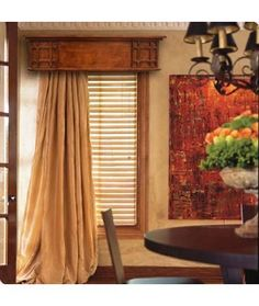 I like the billowing curtains puddling on the floor and pulled to one side under the Kyoto Cornice.  Sharp.