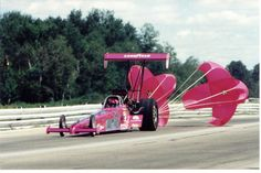 Danica Patrick driving Pink Car for Breast Cancer