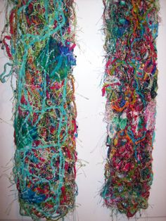 scribble scarf made from silks, cottons, and repurposed yarns and scraps of fabric. This is not knitted but stitched