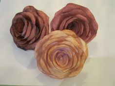Paper roses...simple, cheap, great idea!  Plans for this with different paper and colors..