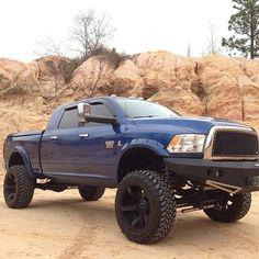 blue lifted dodge ram truck