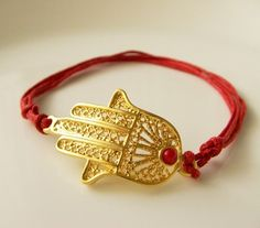 Gold plated brass hamza with red jade bracelet $14.50