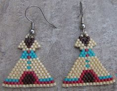 These earrings are done in the brick stitch with size 11 delica seed beads. The colors that I have used are tan, brown, turquoise, and red. These