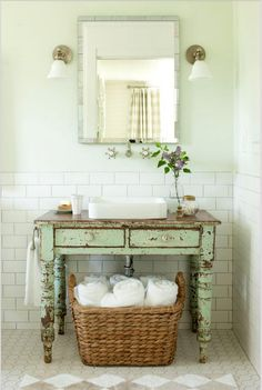 green bathrooms - historical Southern farmhouse Idea Home bath with chippy green table used as a sink vanity - Historical Concepts via Atticmag