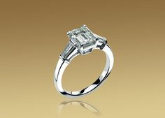 Bulgari Griffe solitaire ring in platinum with emerald cut diamond and 2 side diamonds.: