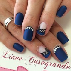 A wonderful looking blue French tip nail art design. This uses midnight blue polish as the base color. The French tip is designed with midnight blue and black polish in lace details with silver beads on top.