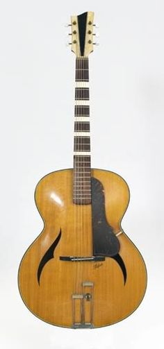 Like the sound hole cutouts on this 50's Hofner archtop acoustic