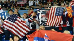 U.S. fans wave the American flag during their team's semifinal win.
