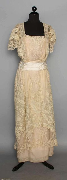 LACE & DRAGONFLY TEA GOWN, c. 1912. 2-piece, bone colored fine cotton lawn lavishly embroidered w/ dragonflies & scrolling foliage, inserts of embroidered net lace, bone chiffon over China silk lining. Front