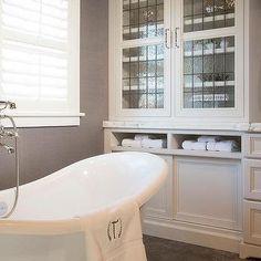 White and Gray Bathroom with Leaded Glass Cabinets