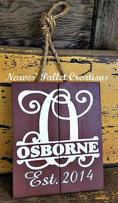"""RECYCLED PALLET WOOD: This personalized Door Hanger is painted Chocolate Brown with hand-painted white text. This one is 12"""" x 14"""" and sold for $22. We can make larger signs if that's what you want. This sign is going outside so we added a coat of poly for added protection. Just let us know what you want and we will help you design something special for your home or maybe to give as a gift for someone else. It's never too early to start thinking about Christmas gifts.  Item# 1,445"""