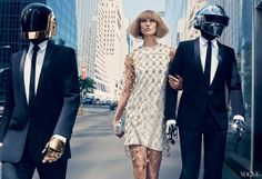 Primodels-Karlie Kloss is joined by electronic music duo Daft Punk in a photo shoot for August's American Vogue.