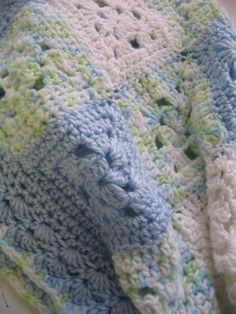 Granny squares - Love the combination of solid & variegate squares.  Also love the style of the squares and the shell edging.