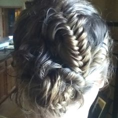 I came up with this myself, idek how i did it. Section off a side of your head, and fish tail that section. afterwards, just do a messy bun and you're good to go! Thanks hailee for being my hair model. :)