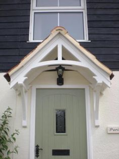 Timber door canopies - traditional cottage canopies - front door canopiesTimber door canopies - traditional cottage canopies - front door canopiesMetal Door Canopy TYPE: L DDA Act CompliantMetal Door Canopy - DDA CompliantI would like Cottage Porch, House With Porch, Porch Design, Cottage Door, Front Door Canopy, Timber Door, Cottage Front Doors, Front Door Porch, Building A Porch