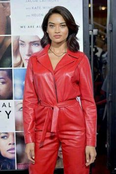 Shanina Shaik hid her slender figure with a billowing red pantsuit on Monday as she attended the Collateral Beauty world premiere in New York. Leather Catsuit, Leather Jumpsuit, Leather Jacket, Red Leather, Red Pantsuit, Collateral Beauty, Shanina Shaik, Latex Dress, Over 50 Womens Fashion