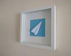 Origami paper plane in a square frame (white plane, white frame)