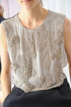 Decorative Metallics - silver rhinestones beads - embellished surface patterns; textured fashion details