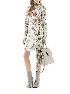 Gucci Flora Knight-Print Silk ShirtdressPearl white flora knight print silk crepe de chine Covered placket with mother of pearl buttons Detachable self fabric belt Silk lining Silk Dry clean Made in Italy