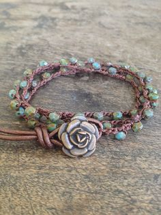Beautiful 4mm multi faceted picasso Czech beads are crocheted onto dark brown nylon cord featuring a lovely antiqued bronze finished rose button closure and metallic brown leather loop. The beads have a beautiful color and makes such a charming piece! Wear as a 3x wrap bracelet,