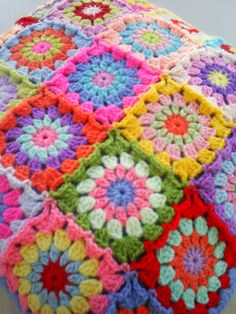 the patchwork granny square cushion cover by handmadebyria on Etsy