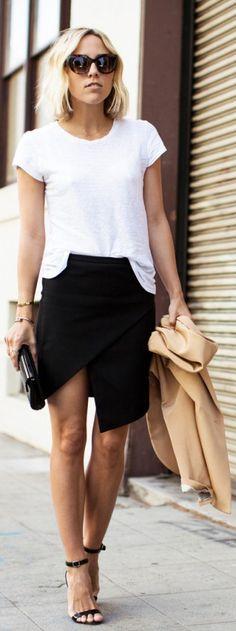 High Slit Skirts: Jacey Duprie is wearing a black Asymmetric wrap skirt