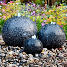 A trio of solid, black granite polished spheres with white LED lights. This feature should not be mistaken for a hollow terrazzo reproduction as it is produced from solid granite and will therefore last for years to come. The included piping, pump and Water Feature Kits, Sphere Water Feature, Modern Water Feature, Backyard Water Feature, Ponds Backyard, Diy Garden Fountains, Small Fountains, Water Fountains, Garden Spheres