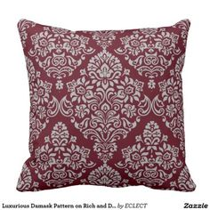 Luxurious Damask Pattern on Rich and Deep Burgundy Throw Pillow  Get some bold decorating home décor ideas by using bold red accent pillows.  You can use red solid throw pillows in combination with red patterned throw pillows.  For example, vertical, chevron and horizontal stripes compliment a solid plush red accent pillow.  Consider using these pillows in your bedroom, living rooms and other spaces with couches, beds, benches and chairs.