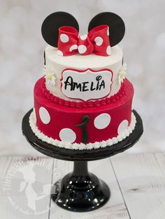 Girl's first birthday red polka dot Minnie Mouse cake with hand-painted name and bow.