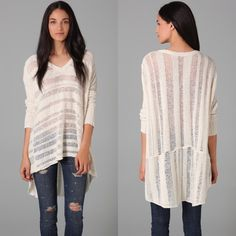 Free People Spending Time Sweater This oversized, V-neck sweater features open-knit stripes and an asymmetrical hem. Raised seams and dropped shoulder seams. Ribbed panels at long sleeves. Sheer.  Worn just a handful of times, this sweater is in wonderful condition. There may be a couple of pulls, but they are minor and hard to see. Only real flaw is the metal FP tag is unattached on one side.  Shell: 72% cotton/13% rayon/6% acrylic/5% nylon/3% wool/1% alpaca Ribbing: 88% cotton/12% rayon…