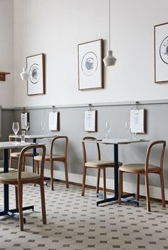 A beautiful simple scandinavian restaurant design - Finlandia Caviar, Helsinki by Joanna Laajisto, half grey walls, patterned tiled floors and minimal furniture