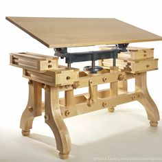 Nice drawing surface, work-desk.  This would be perfect in a dark mahogany or black walnut. #WoodworkingBench