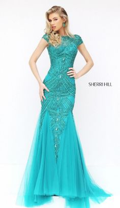 Sherri Hill has the most flattering and fashionable cocktail dresses to spice up your next party! Style 50516 available at WhatchamaCallit Boutique.