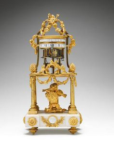 A late 18th century French ormolu and marble annular dial clock Le Roy, Paris