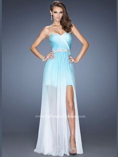 Channel this very cute and trendy La Femme prom dress 20028 which is made of ombre chiffon fabric in a wrap-around design that's topped off by a ruched strapless sweetheart bodice. The natural waist is beaded belted, while a mini gathered underskirt is accentuated with a split long overlay which gives a hi-low twist. Criss-cross jeweled straps adorn the open back. Add panache with sexy peep toe pumps.