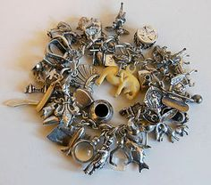 1940s sterling silver 45-charm collection from Planetclairevintage (Etsy) https://www.etsy.com/listing/214745088/charm-bracelet-45-charms-loaded-charming?g